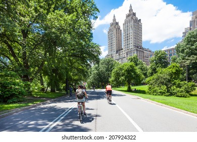 NEW YORK CITY, NEW YORK, USA - JUNE 14, 2014: Cyclists and joggers on Central Park East Drive on June 14, 2014. Central Park is a haven for the active lifestyle during the summer season.