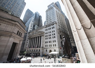 NEW YORK CITY, USA - JUNE 21, 2016: A view of Wall Street from the steps of the Federal Hall on a sunny day. Lower Manhattan, New York City.