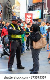 New York City, USA - June 7, 2017: Times Square Alliance Public Safety Officer attending to a tourist