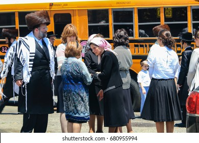 New York City, USA - June 10, 2017: Two Orthodox jewish women speaking and wearing Special Clothes on Shabbat, in Williamsburg, Brooklyn, New York