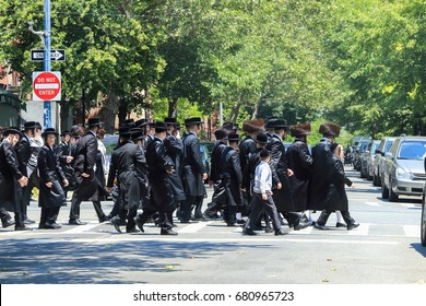 New York City, USA - June 10, 2017: Orthodox Jews Wearing Special Clothes on Shabbat, in Williamsburg, Brooklyn, New York