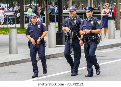 New York City, USA - June 8, 2017: Armed police officers patrol at a Manhattan street in New York City on June 8, 2017