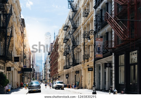 New York City, USA - June Scenic view of Greene Street with luxury fashion retail stores in Soho Cast Iron historic District in New York City.