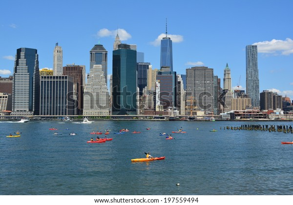 NEW YORK CITY, USA - June 6, 2014: People kayaking on the East River with the Lower Manhattan skyline in the background.