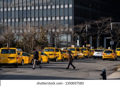 New York City - USA - Mar 11 2019: A general street view of yellow cabs waiting in South Ferry area in Financial District Lower Manhattan New York City