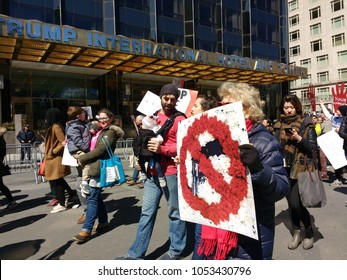 New York City, New York / USA - March 24 2018: Demonstrators pass the Trump International Hotel & Tower on Central Park West during the March for Our Lives in New York City.