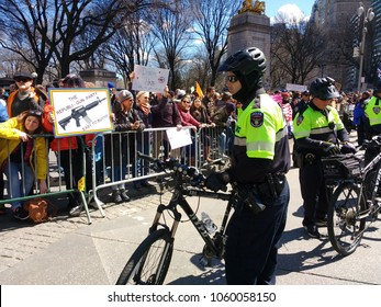 New York City, New York / USA - March 24 2018: The NYPD Strategic Response Group (SRG) Bicycle Squad stands between marchers and Trump supporters at Columbus Circle during the March for Our Lives.