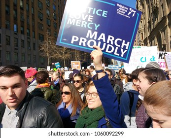 New York City, New York / USA - March 24 2018: Demonstrators on West 72nd Street, near The Dakota, during the March for Our Lives in New York City.