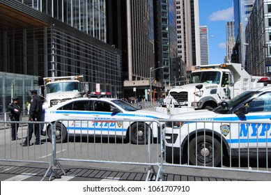 New York City, New York / USA - March 24 2018: NYPD police blockade at the corner of 6th Avenue and West 42nd Street during the March for Our Lives in New York City.