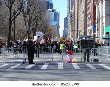 New York City, New York / USA - March 24 2018: March for Our Lives: Crowd control at the intersection of West 69th Street and Central Park West.