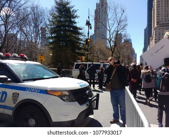 New York City, New York / USA - March 24 2018: A photographer documents the demonstration on Central Park West during the March for Our Lives in New York City.