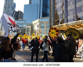 New York City, New York / USA - March 24 2018: Demonstrators near the Trump International Hotel & Tower on Central Park West during the March for Our Lives in New York City.