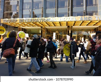 New York City, New York / USA - March 24 2018: Demonstrators, including one on crutches, parade by the Trump International Hotel & Tower on Central Park West during the March for Our Lives.