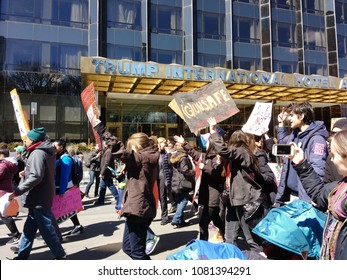 New York City, New York / USA - March 24 2018: Protesters pass by the Trump International Hotel & Tower during the March for Our Lives in New York City.