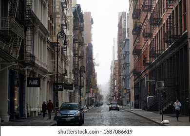 New York City, New York / USA - March 29 2020: Empty streets of New York City without people on 5th Avenue at Soho area with closed shops and outlets during pandemic coronavirus outbreak