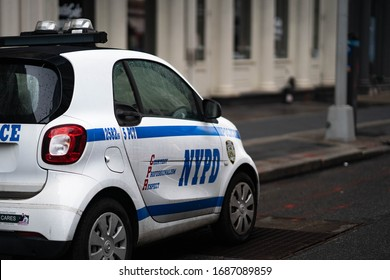 New York City, New York / USA - March 29 2020: Police NYPD cars standing patrolling New York City empty streets in soho during pandemic outbreak coronavirus cover-19 in New York City