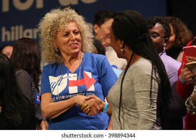 New York City, New York, USA, March 31, 2016; Women shake hands before Democratic Presidential Candidate Hillary Clinton speaks at the Apollo Theater in Harlem, New York City.