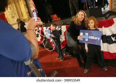New York City, New York, USA, March 31, 2016;  A woman and her son pose before Democratic Presidential Candidate Hillary Clinton speaks at the Apollo Theater in Harlem, New York City.