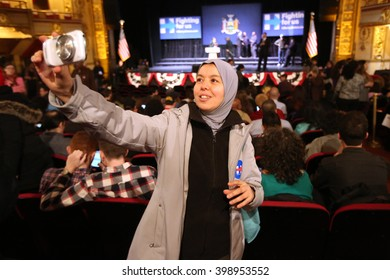 New York City, New York, USA, March 31, 2016; Muslim American Aicha Iharrtane does a selfie before the Democratic Presidential Candidate Hillary Clinton rally Apollo Theater in Harlem, New York City.