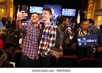 New York City, New York, USA, March 31, 2016; Couple Robert Lomangino and Patrick Ford-Matz do a selfie before a Hillary Clinton rally at the Apollo Theater in Harlem, New York City.