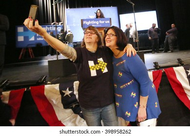 New York City, New York, USA, March 30, 2016; Two women do a selfie before Democratic Presidential Candidate Hillary Clinton speaks at the Apollo Theater in Harlem, New York City.