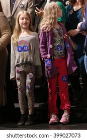 New York City, New York, USA, March 30, 2016;  Girls Ruby and Lilah Arthur pictured before Democratic Presidential Candidate Hillary Clinton speaks at the Apollo Theater in Harlem, New York City.
