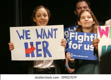 New York City, New York, USA, March 30, 2016;  Young girls hold signs before Democratic Presidential Candidate Hillary Clinton speaks at the Apollo Theater in Harlem, New York City.