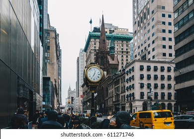 New York City ,USA - March 18, 2017. The Trump Tower on Fifth Avenue, typical  skyscrapers common in Manhattan and old gold analogue hour.