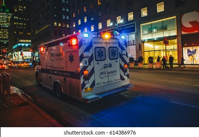 New York City, USA - March 18, 2017: FDNY Ambulance flashing lights siren blasting in action in Manhattan.