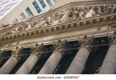 New York City, USA - March 19, 2014: Facade of the New York Stock Exchange on Wall Street. Is the largest exchange market in the world by market capitalization.