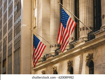 New York City, USA - March 19, 2017: Facade of the New York Stock Exchange on Wall Street. Is the largest exchange market in the world by market capitalization.