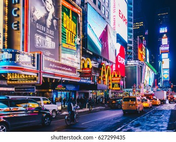 New York City, USA- March 18, 2017: Times Square, featured with Broadway Theaters and animated colorful LED signs, stores, and lots of tourists and locals, is a symbol of NYC and the USA in Manhattan.