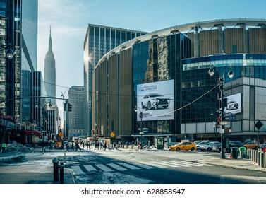 New York City, USA - March 19, 2017: Pennsylvania Station and at the bottom Empire Stete Building.This major inner city commuter rail hub in NYC serves 300,000 passengers a day.