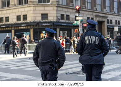 New York City, USA - March 17, 2017: NYPD officers watching the St. Patrick's Day Parade in Midtown Manhattan, NYC.