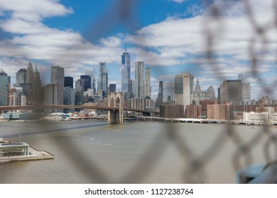 NEW YORK CITY, NEW YORK, USA MAY 2018: Brooklyn Bridge and the view of Manhattan. Editorial only.