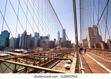 NEW YORK CITY, USA - MAY 24: Traffic on the Brooklyn Bridge with the Lower Manhattan skyline in the background at May 24, 2015 New York, USA.