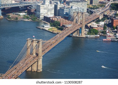 New York City, USA - May 31, 2015: The Brooklyn Bridge over East River viewed from World Trade Center on May 31, 2015. Brooklyn Bridge is one of the oldest suspension bridges in the United States.