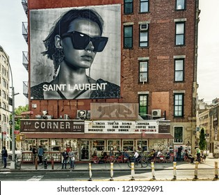"New York City, USA, May 2018, facade of the building of the Mexican restaurant ""La Esquina"" in Soho with a billboard above."