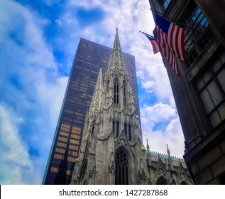NEW YORK CITY, USA, May 31 2017: Saint Thomas Church in Fifth Avenue among skyscrapers in New York City, USA.
