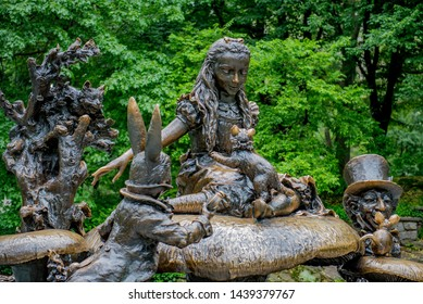 New York City, New York / USA - May 28 2019: The Alice in Wonderland statue in Central Park. Philanthropist George Delacorte commissioned this bronze statue as a gift to the children of NYC in 1959.