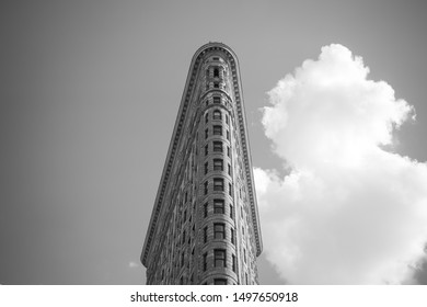 New York City , USA - May, 2017 : Flatiron Building ( Fuller Building) in Manhattan, New York City. It is a triangular steel-framed landmarked building located at Fifth Avenue in black and white tone
