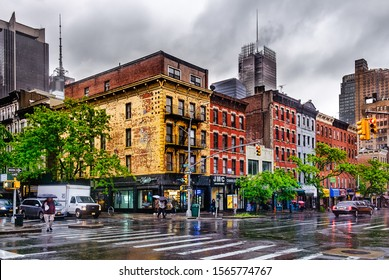 New York City, USA, May 2019, urban scene on a rainy day on the W 47 & 9th Avenue in Hell's Kitchen, Manhattan