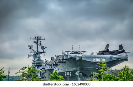 New York City, U.S.A, May 2019, view of the Intrepid Sea, Air & Space Museum from the street on a overcast day located at Pier 86 at 46th Street in the Hell's Kitchen neighborhood