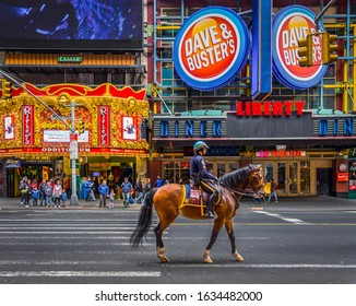 New York City, U.S.A, May 2019, a single American Horse Police walking on the 42nd st between the 8th and 7th avenue