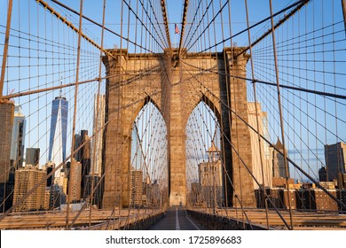 New York City, New York / USA - May 8 2020: Brooklyn Bridge in New York city. Close up brownstone Brooklyn bridge. Manhattan skyline view from the bridge.