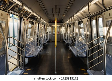 New York City, New York / USA - May 8 2020: Empty trains and subway cars in New York City during coronavirus pandemic outbreak in New York City. Empty subway train cars during daytime.