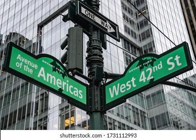New York City, New York / USA - May 14 2020: New York City street signs. Direction pedestrian sign. Green Manhattan street sign. Empty New York street.