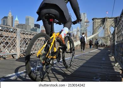New York City, USA, - May. 19. 2014: Bike riders commuting to Manhattan over Brooklyn Bridge. New York, USA