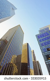 NEW YORK CITY, USA - MAY 7, 2015: Low angle view of skyscrapers in the Financial District of New York City, USA.
