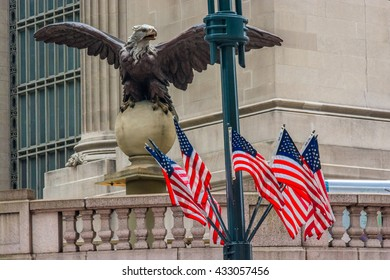 NEW YORK CITY, NEW YORK, USA  MAY 22, 2013:  Eagle and American flags on Vanderbilt Avenue